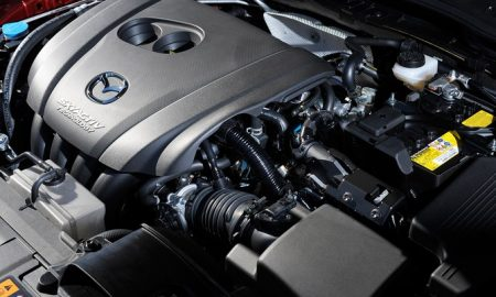 MAZDA'S CRAFTY NEW ENGINE MAKES MORE MILES FROM LESS FUEL